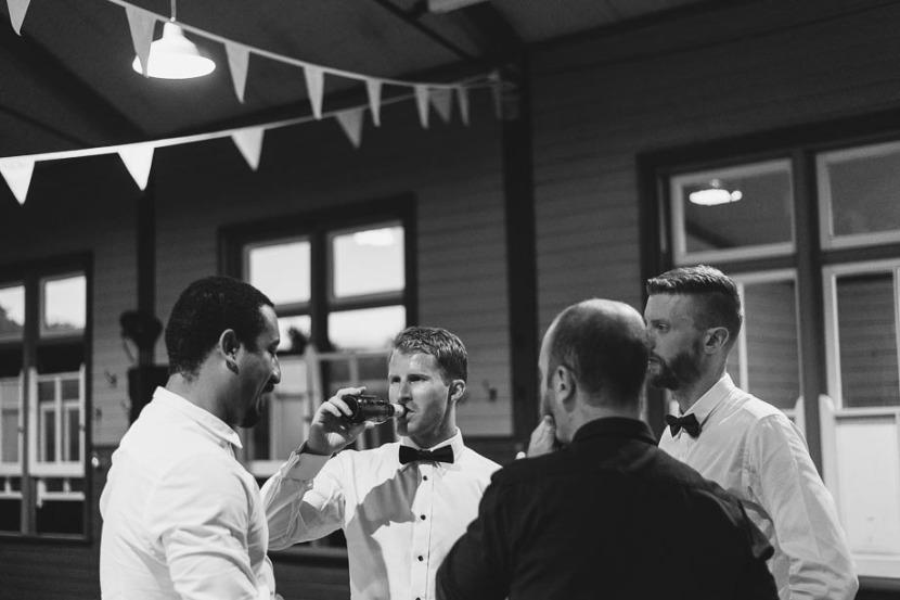 groom-drinking-beer-with-men