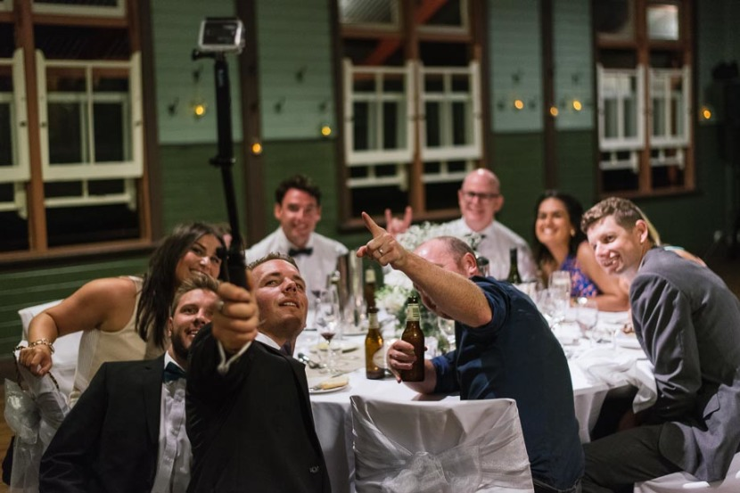 man-taking-selfie-q-station-wedding