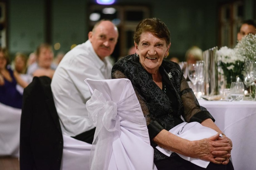elderly-lady-laughing-during-wedding-speeches