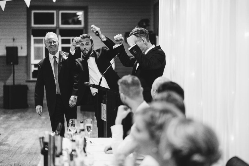 men-cheering-during-wedding-speeches
