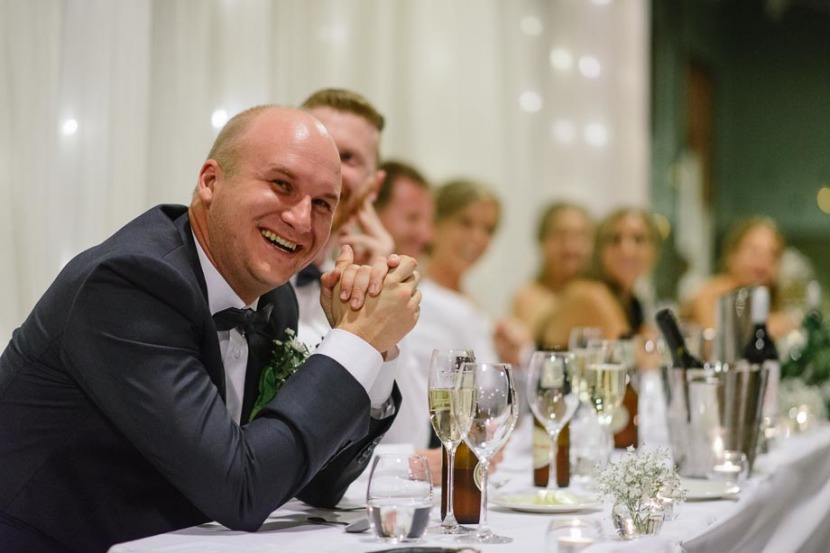 groomsman-laughing-during-wedding-speeches