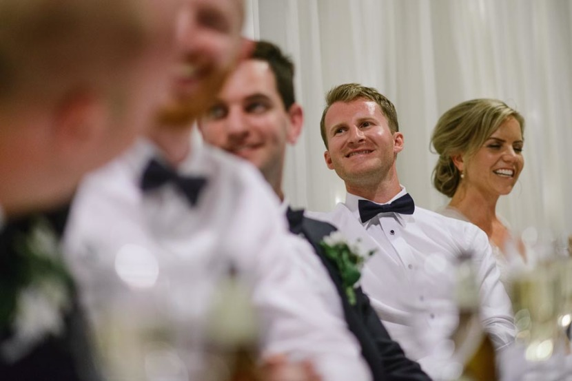 groom-laughing-during-wedding-speeches