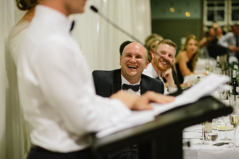 groomsman-laughing-during-wedding-speeches