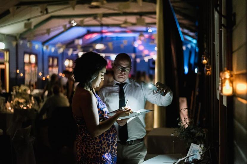 man-lighting-wedding-guest-book