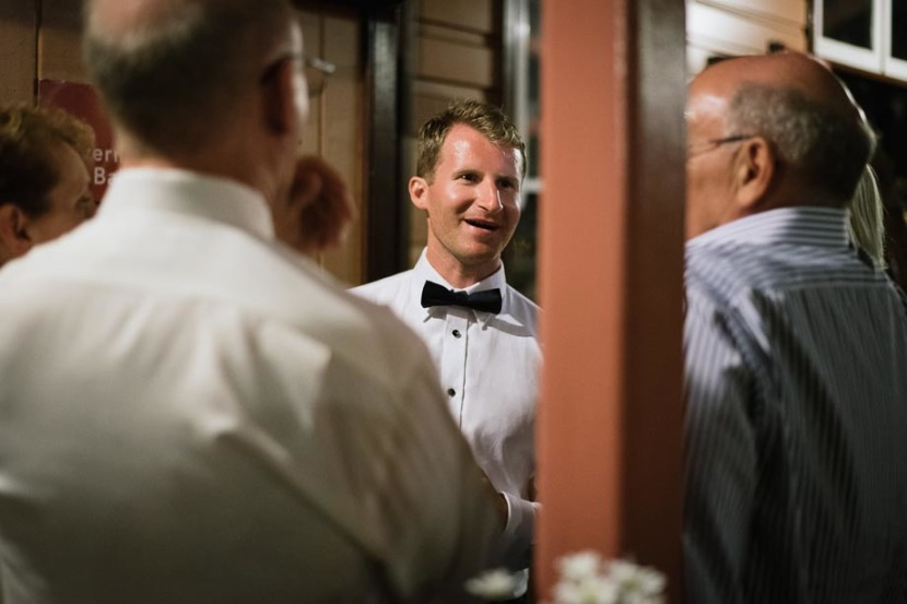 groom-laughing-with-wedding-guests