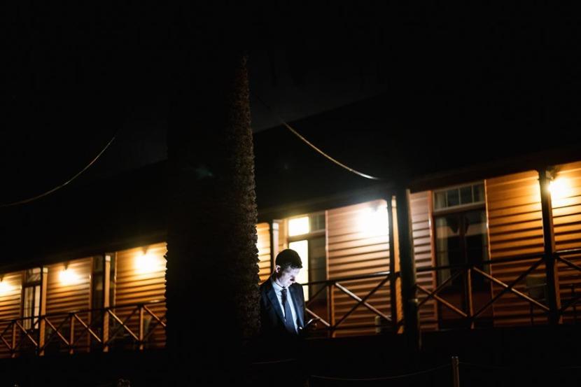 man-on-mobile-phone-at-night