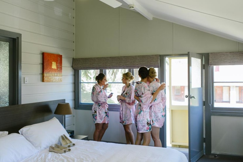 bridesmaids-hugging-in-dressing-gowns