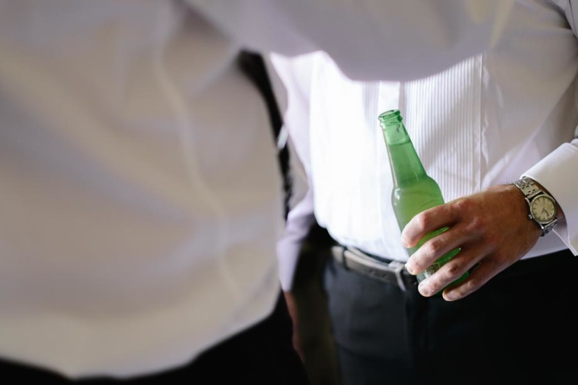 groom-holding-beer-bottle