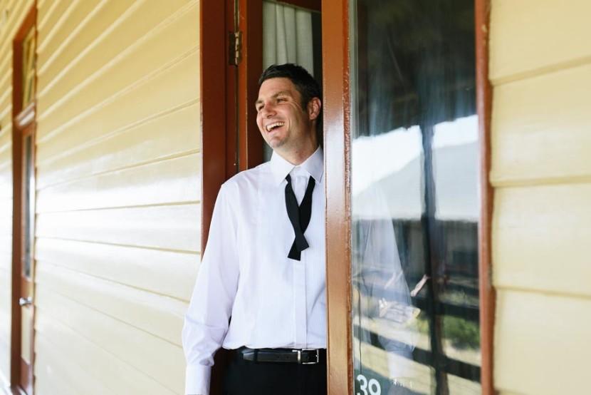 groom-in-doorway-laughing