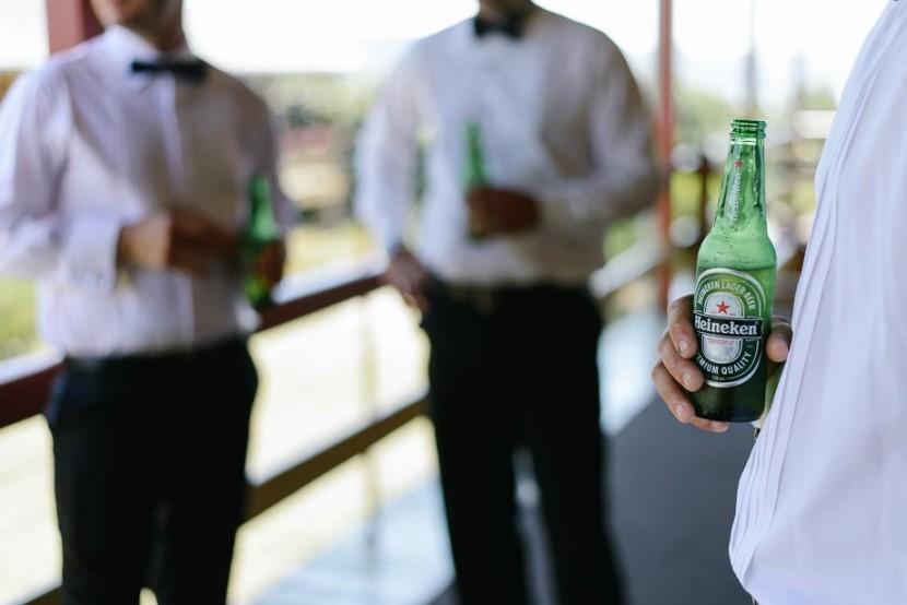 groom-holding-bottle-beer