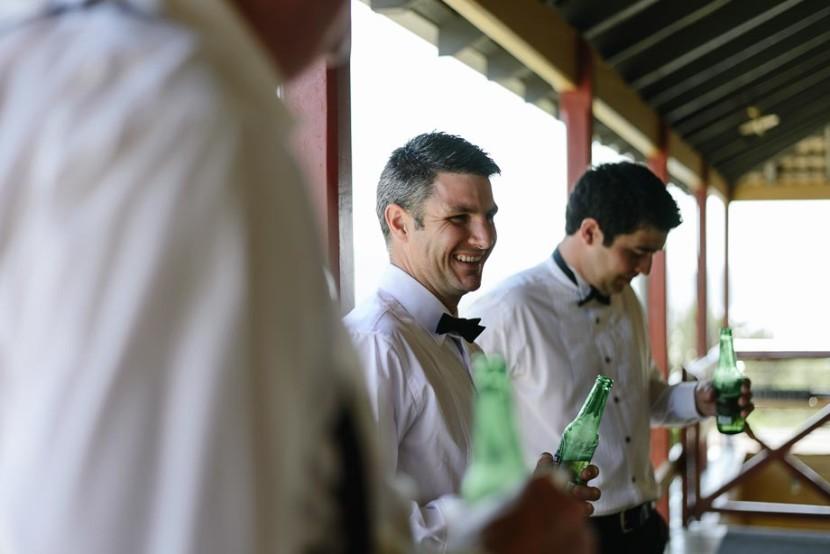 groom-laughing-drinking-beer