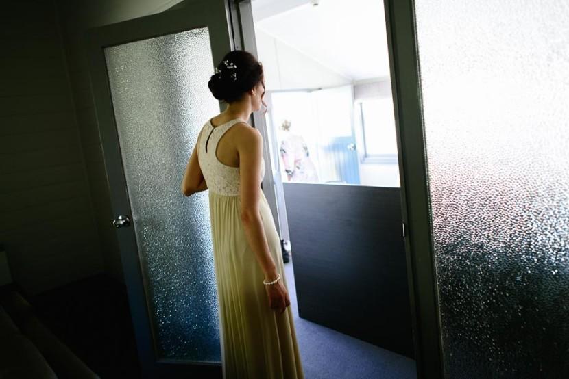 girl-looking-through-glass-door