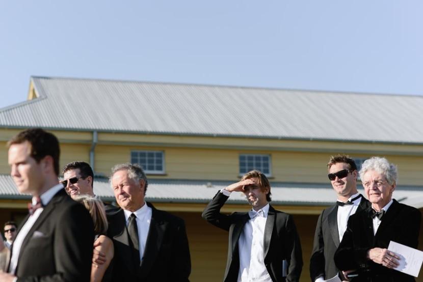 man-sheilding-eyes-wedding-ceremony-manly-q-station