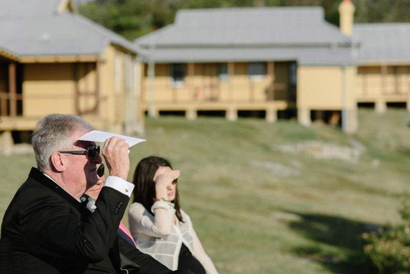 guests-sheilding-eyes-wedding-ceremony-manly-q-station