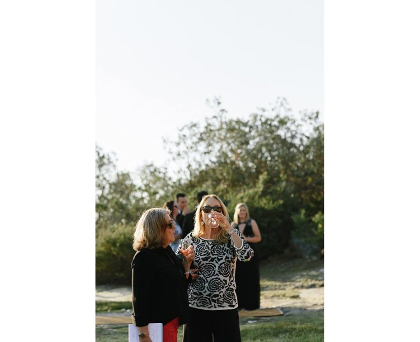 woman-drinking-champagne-wedding-ceremony-manly-q-station