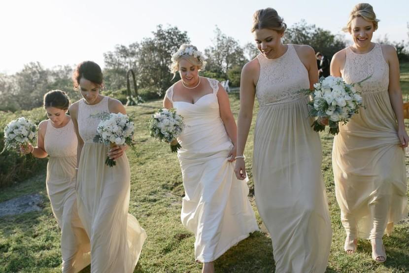 bridal-party-walking-in-setting-sun