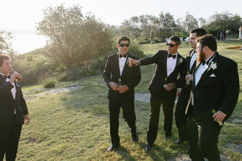 groomsmen-talking-in-field