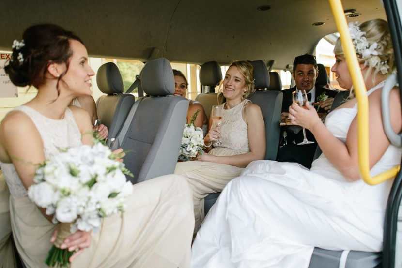 bridal-party-laughing-in-bus