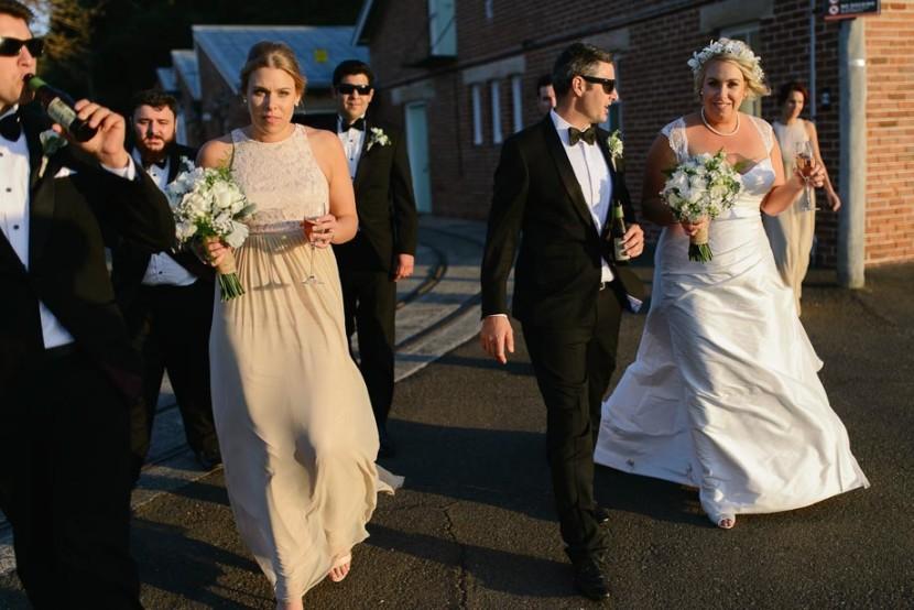 wedding-party-walking-on-wharf