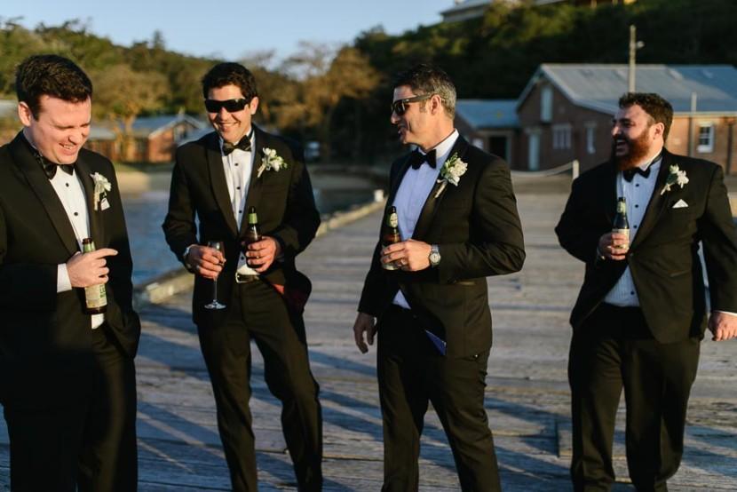 groomsmen-laughing-on-wharf