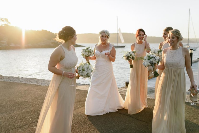 bridal-party-laughing-on-wharf