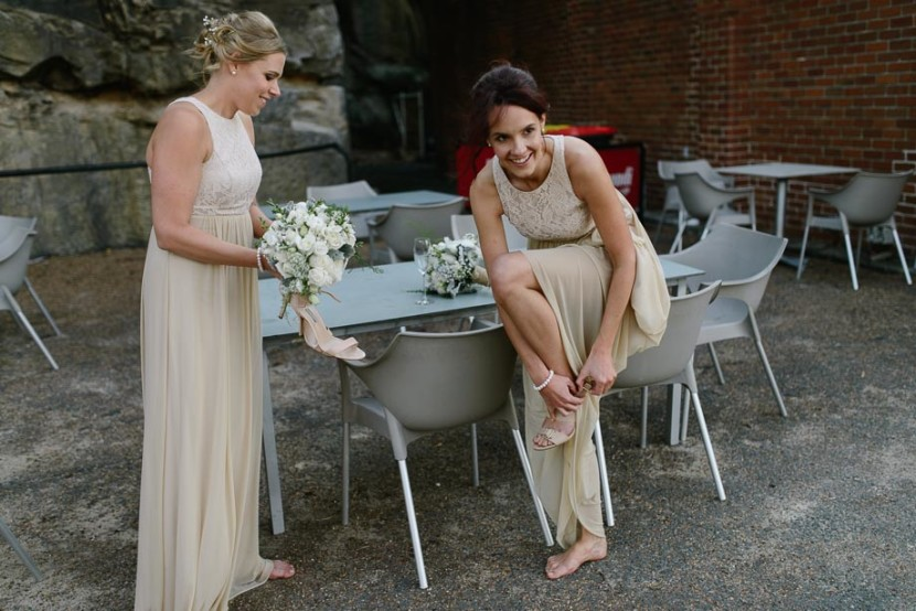 bridesmaid-putting-on-shoes