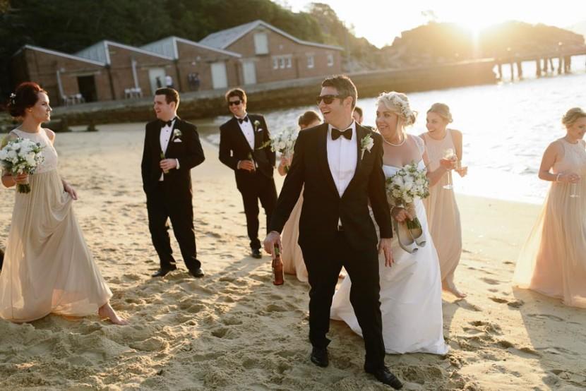 wedding-party-walking-on-beach
