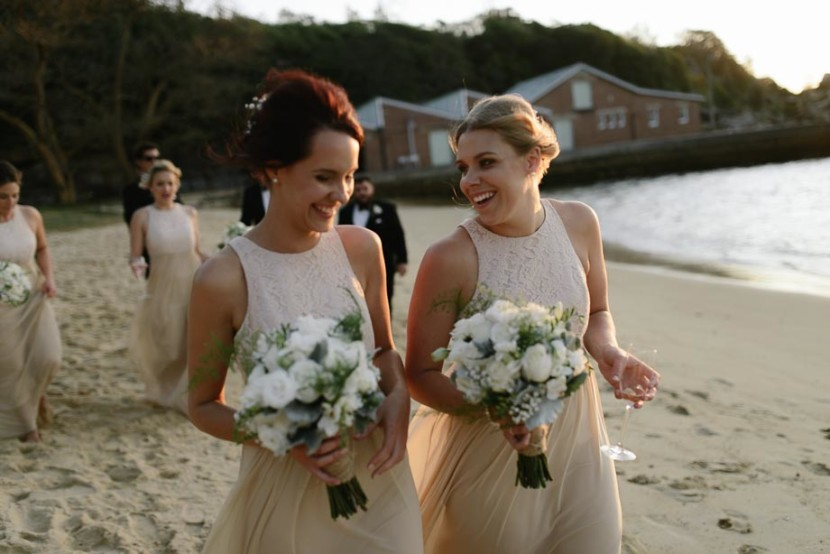 bridesmaids-laughing-on-beach
