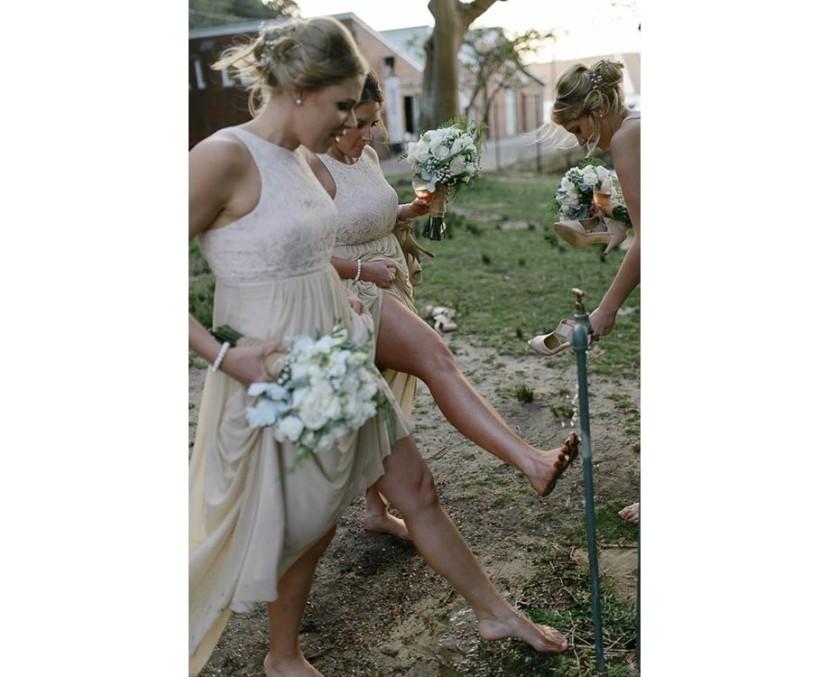 bridesmaids-washing-feet-under-tap
