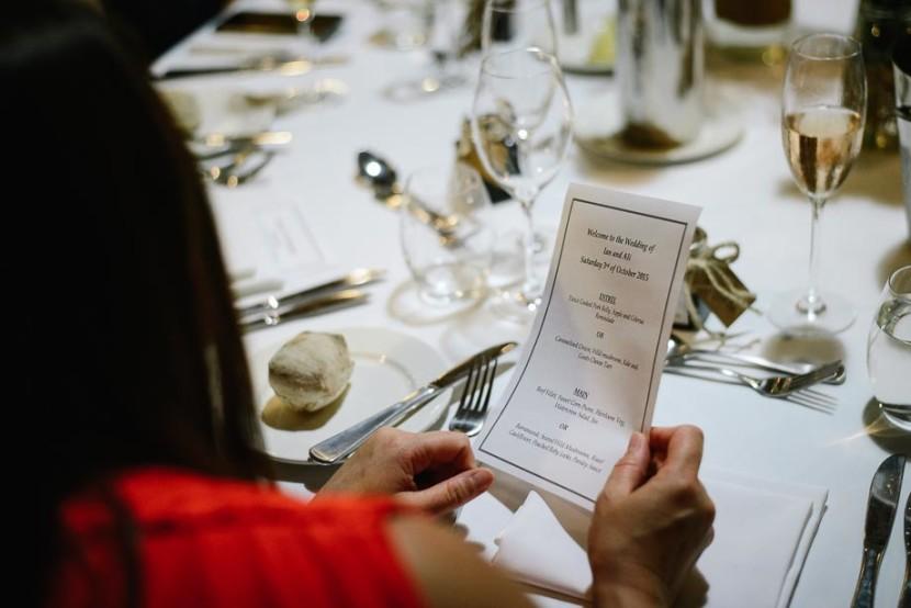 woman-holding-wedding-menu