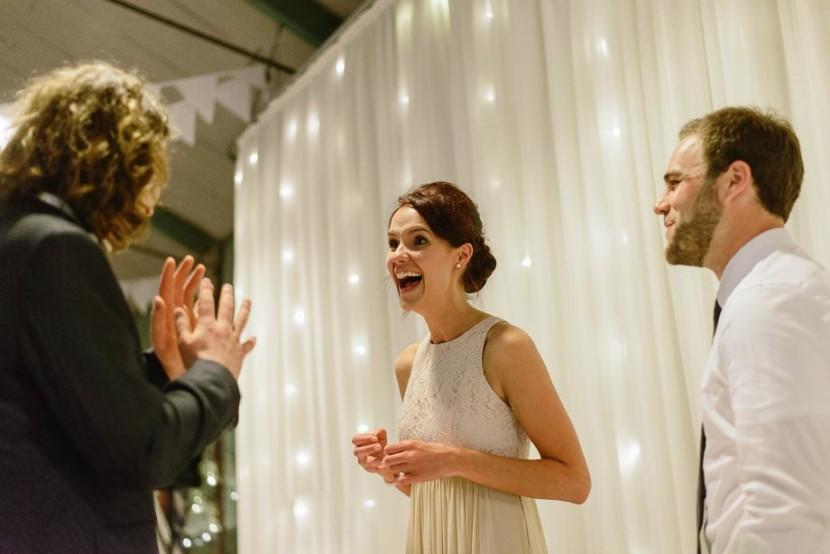 bridesmaid-laughing-at-wedding-reception