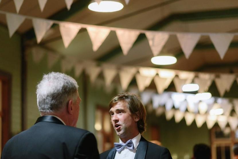 men-talking-at-wedding-reception