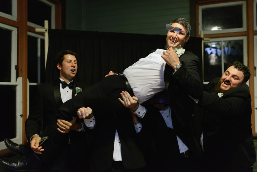groomsmen-in-photo-booth