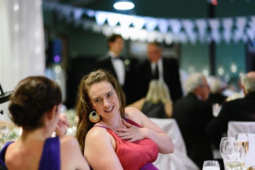 two-woman-talking-at-wedding