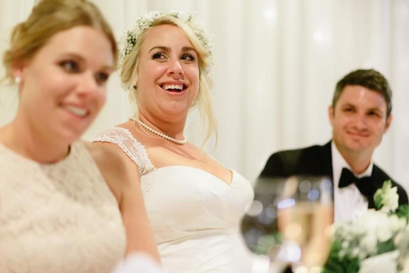 bride-laughing-during-wedding-speech