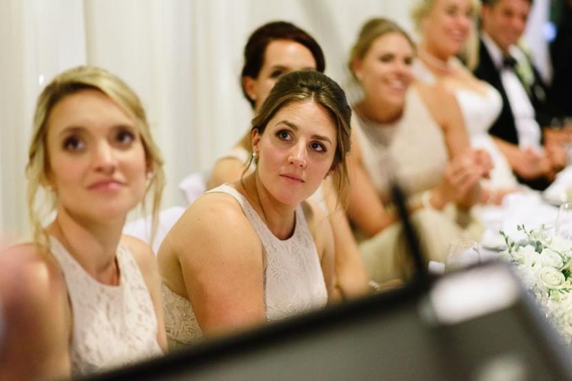 bridesmaid-listening-to-wedding-speech