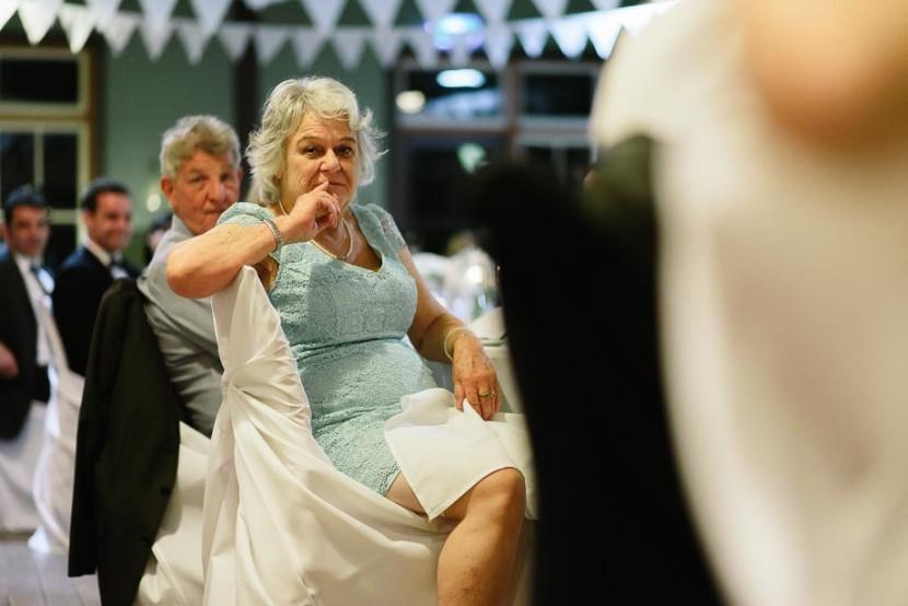 woman-sitting-listening-to-wedding-speech