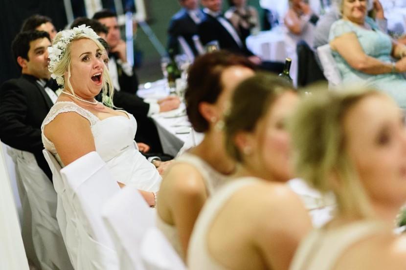 bride-laughing-at-wedding-speech