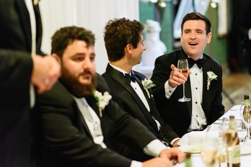 man-laughing-sat-at-table