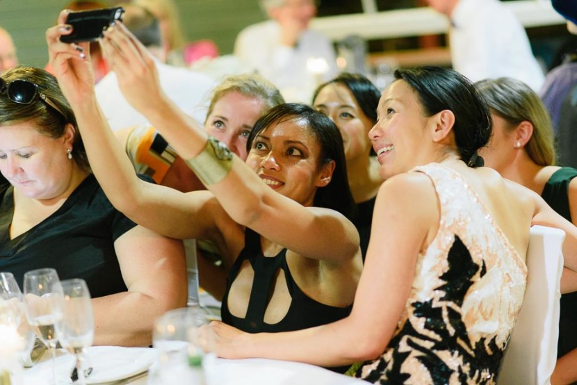 woman-taking-group-selfie-photo