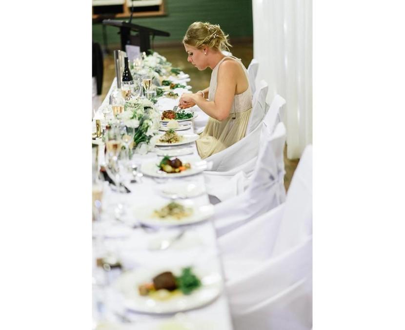 bridesmaid-sat-eating-wedding-meal