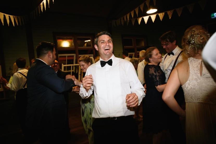 groom-laughing-on-dancfloor