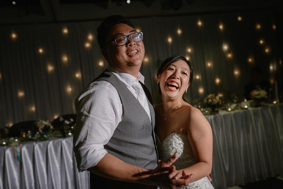 bride-groom-laughing-during-wedding-dance