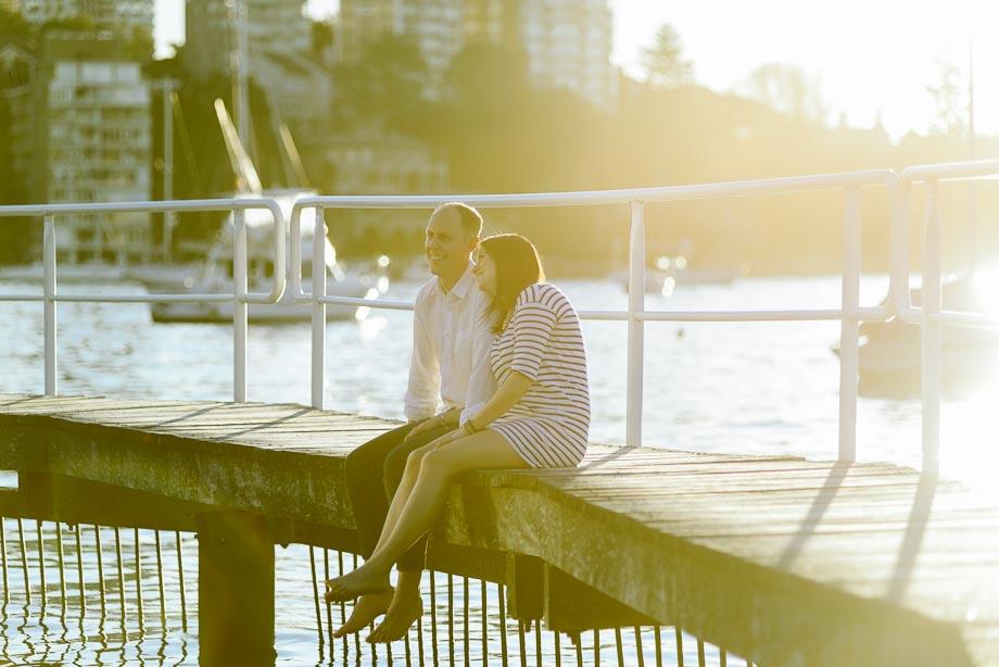 couple-sitting-sunset-wharf