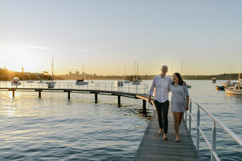 couple-walking-on-sunset-wharf