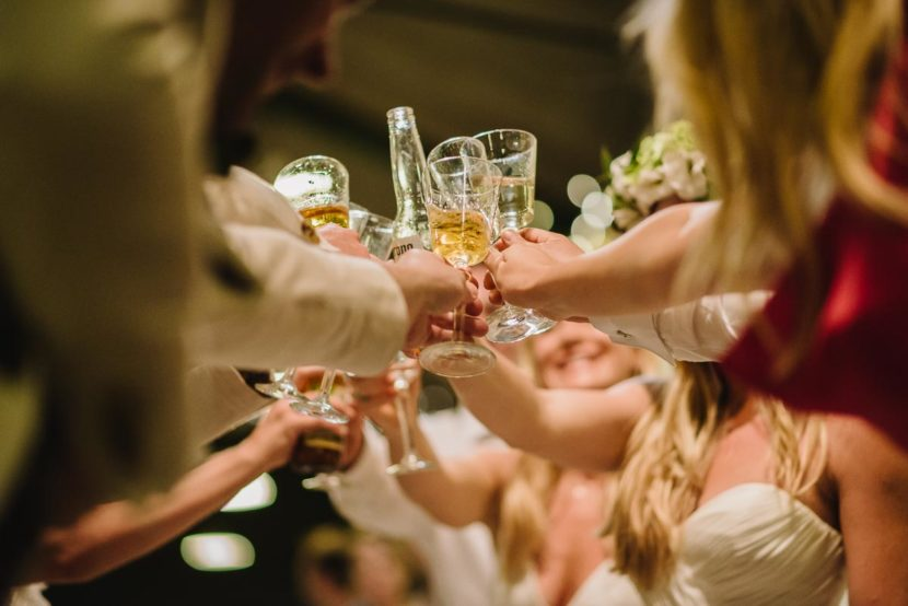 drink-glasses-cheering-wedding-party