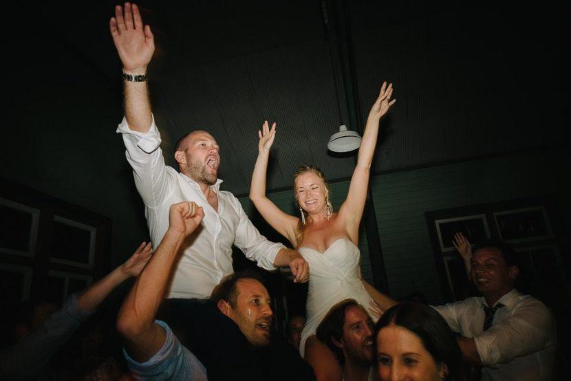 bide-groom-on-shoulders-dancing