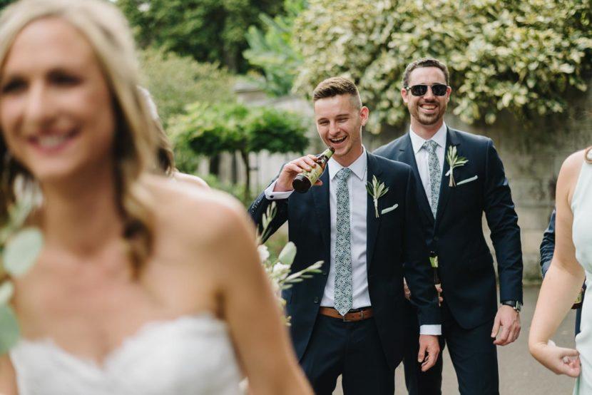 wedding-party-walking-through-botanical-gardens