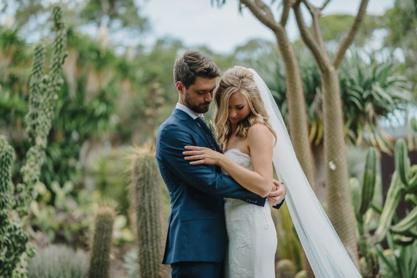 bride-groom-hugging-cactus-garden
