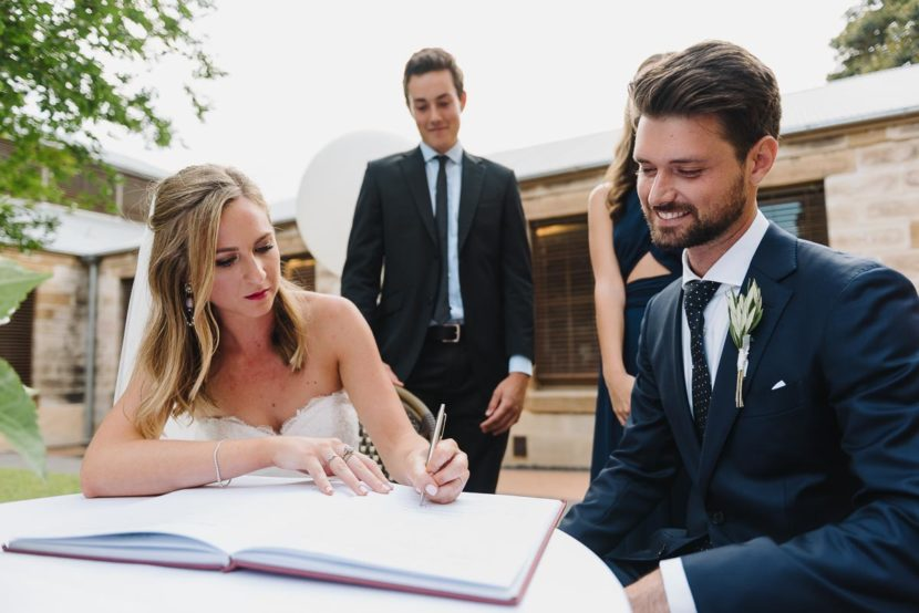 bride-groom-signing-wedding-certificates-sydney-wedding